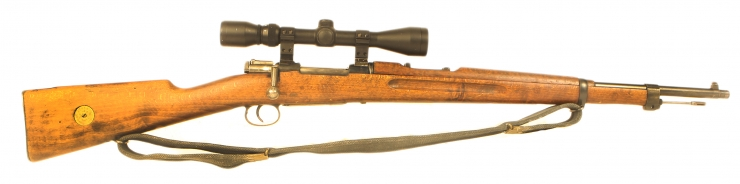 Deactivated WWII Swedish military Husqvarna rifle fitted with scope and mounts
