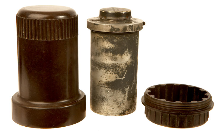 An original WWII German Luftwaffe fuse with its Bakelite transportation case.